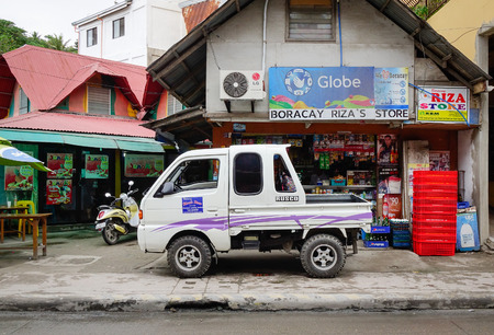 Kalibo, Philippines - Dec 17, 2015. Vehicles on street in Boracay island, Philippines. Boracay Island has received awards from numerous travel publications and agencies.