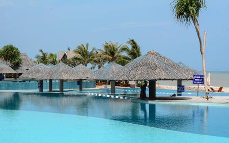 inground: Vung Tau, Vietnam - June 30, 2015. Residential inground swimming pool in Vung Tau, Vietnam. Vung Tau is a port city on a peninsula in southern Vietnam.