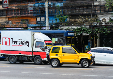 Bangkok, Thailand - Nov 10, 2015. Traffic on a busy road in the city centre in Bangkok, Thailand. Annually an estimated 150,000 new cars join the heavily congested roads of Bangkok.