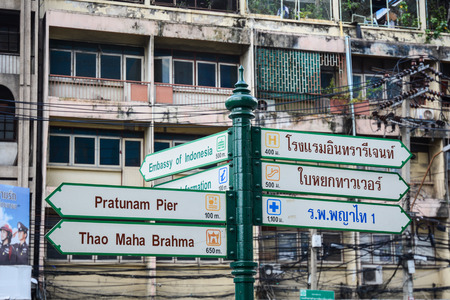bilingual: Bangkok, Thailand - Nov 10, 2015. Close up of bilingual direction signpost in Bangkok, Thailand. Editorial