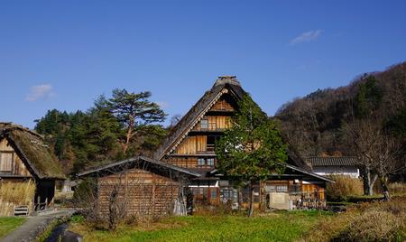 A wooden house located at Historical Japanese village Shirakawago at the sunny day in Gifu, Japan. Stock Photo