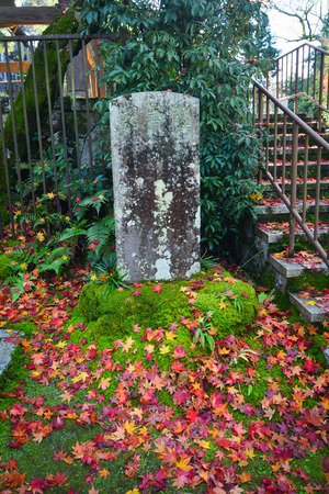 stele: Autumn scenery with stone stele at traditional garden in Kyoto, Japan.