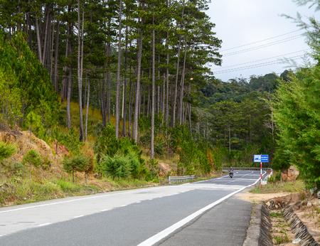 Dalat, Vietnam - Jan 25, 2016. Mountain road in Dalat, Vietnam. In Vietnam, Da Lat is a popular tourist destination. Sajtókép