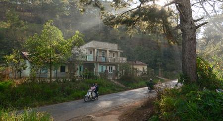 Dalat, Vietnam - Jan 23, 2016. Motorbike running on the mountain road in Dalat, Vietnam. In Vietnam, Da Lat is a popular tourist destination.