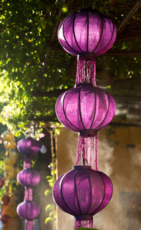 Traditional purple lanterns in the ancient town of Hoi An, Vietnam. Hoi An possessed the largest harbour in Southeast Asia in the 1st century. Stock Photo