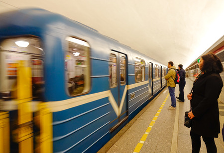 sub station: Saint Petersburg, Russia - Oct 9, 2016. People at the underground metro station in Saint Petersburg, Russia. Saint Petersburg has a significant historical and cultural heritage.