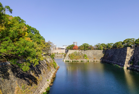 Fortress wall of Osaka Castle in Osaka, Japan. Osaka Castle Park opened in 1931 and covers an area of 106.7 hectare.