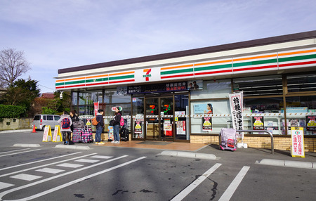 KYOTO, JAPAN - DEC 4, 2016. Facade of 7-Eleven convenience store in Kyoto, Japan. 7-Eleven is world's largest operator, franchisor of convenience stores, with more than 46,000 shops.