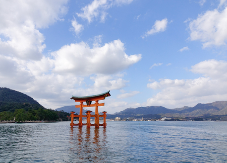 vermilion coast: Floating gate (Giant Torii) of Itsukushima Shrine under blue sky in Hiroshima, Japan. The temple is a UNESCO World Heritage Site. Editorial