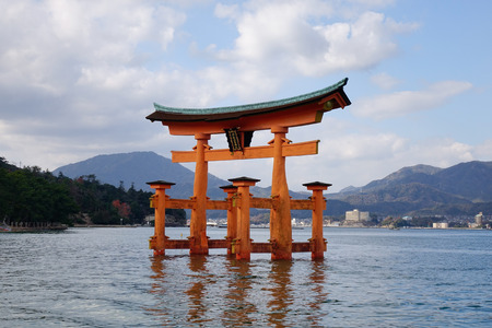 vermilion coast: Floating gate (Giant Torii) of Itsukushima Shrine in Hiroshima, Japan. The historic shrine complex is listed as a UNESCO World Heritage Site.