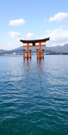 vermilion coast: Floating gate (Giant Torii) of Itsukushima Shrine at sunny day in Hiroshima, Japan. The historic shrine complex is listed as a UNESCO World Heritage Site.