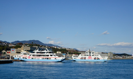Hiroshima, Japan - Dec 28, 2015. Tourist ferries on the sea to Miyajima Island in Hiroshima, Japan. Miyajima has a number of temples, including Toyokuni Shrine.