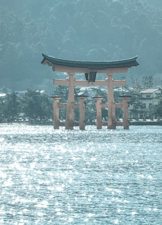 vermilion coast: Floating gate (Giant Torii) of Itsukushima Shrine at sunny day in Hiroshima, Japan. The temple is a UNESCO World Heritage Site.