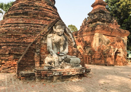 Buddha statue in the ancient temple in Inwa, Myanmar. Inwa is an ancient imperial capital of successive Burmese kingdoms from the 14th to 19th centuries.