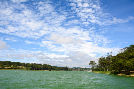 View of Xuan Huong Lake with pine trees in Dalat, Vietnam. Dalat is a city located on Lang Biang highlands – part of the Central Highlands region of Vietnam.