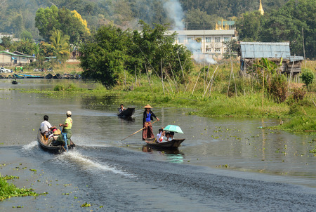Inle, Myanmar - Feb 14, 2016. Traffic on the river in Inle, Myanmar. Inle Lake is a freshwater lake located in the Nyaungshwe Township of Shan State. Editorial