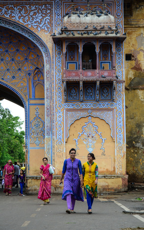 trash the dress: Jaipur, India - Jul 27, 2015. Indian women in colorful sarees walking on street in Jaipur, India. Jaipur, known as the Pink city, is a major tourist destination in India.