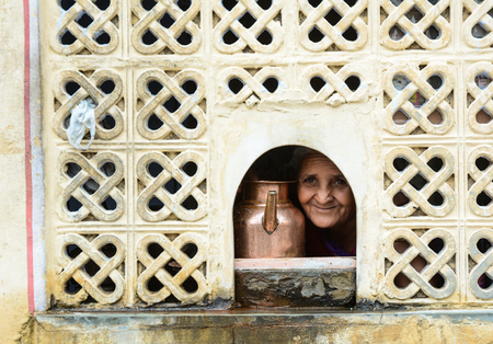 mughal empire: Jaipur, India - Jul 27, 2015. India woman with water pot in old house in Jaipur, India. Jaipur is the capital and largest city of the Indian state of Rajasthan.