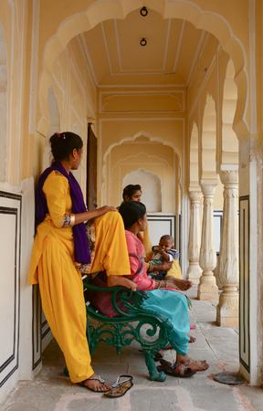 trash the dress: Jaipur, India - Jul 27, 2015. Indian women at the lobby of an old building in Jaipur, India. Jaipur, known as the Pink city, is a major tourist destination in India.