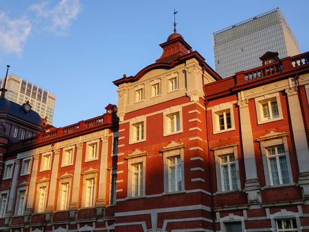 The Main Station at sunset in Tokyo, Japan. Open in 1914, a major a railway station near the Imperial Palace grounds and Ginza commercial district.