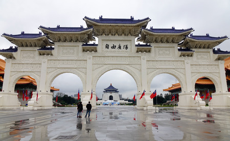 archways: Taipei, Taiwan - Jan 6, 2016. People at the Chinese archways located on Liberty Square in Taipei, Taiwan. Famous Chiang Kai-Shek Memorial Hall viewable in the middle of the arches.