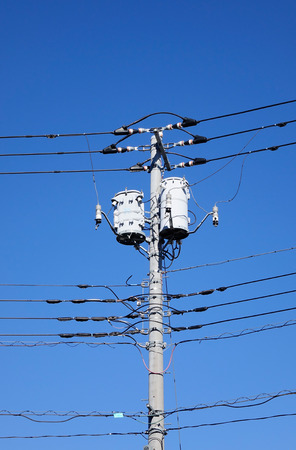telephone poles: Wire electric pylon under the blue sky in Tokyo, Japan. Stock Photo