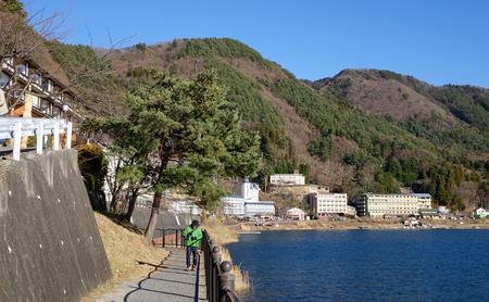 kawaguchi ko: Yamanashi, Japan - Jan 1, 2016. Tourists walking on trail near Kawaguchi-ko Lake in Japan. Lake Kawaguchi is located in southern Yamanashi near Mount Fuji, Japan.