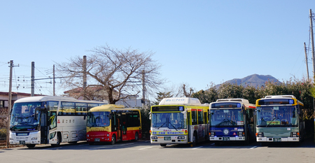 Kyoto, Japan - Jan 1, 2016. Buses parking on street at downtown in Kyoto, Japan. Kyoto is famous for its numerous classical Buddhist temples, as well as gardens, imperial palaces.