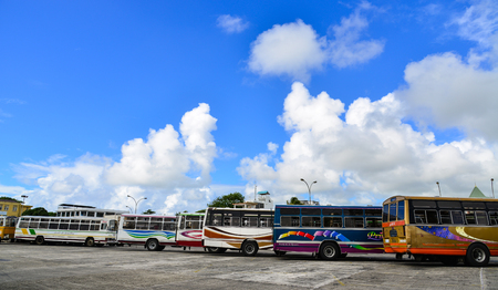 Mahebourg, Mauritius - Jan 4, 2017. Buses parking at main station in Mahebourg, Mauritius. Mahebourg is a small city on the south-eastern coast of Mauritius.