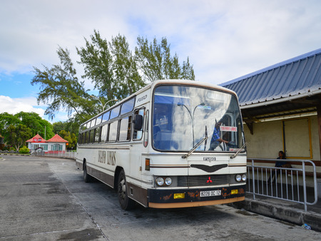 knew: Mahebourg, Mauritius - Jan 4, 2017. Local bus at station in Mahebourg, Mauritius. Mahebourg knew major development around 1806 during the French colonisation era.