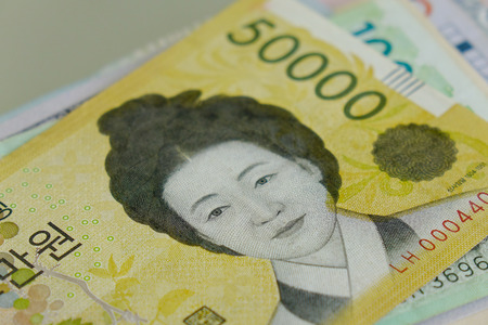 Portrait of the queen on Korean banknote. Close up.