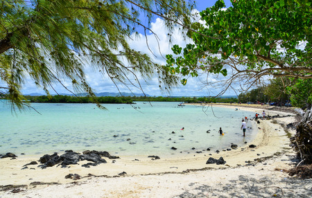 Mahebourg, Mauritius - Jan 7, 2017. People enjoy on the beach in Mahebourg, Mauritius. The environment in Mauritius is typically tropical in the coastal regions. Editorial