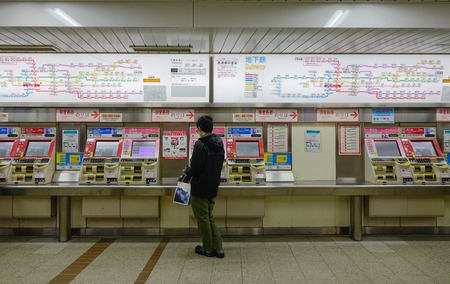 Tokyo, Japan - Nov 24, 2016. A man buying tickets at the metro station in Tokyo, Japan. In 2014, Tokyo Metro had an average daily ridership of 6.84 million passengers.
