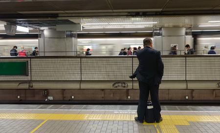 Tokyo, Japan - Nov 24, 2016. A man waiting at the metro station in Tokyo, Japan. In 2014, Tokyo Metro had an average daily ridership of 6.84 million passengers.