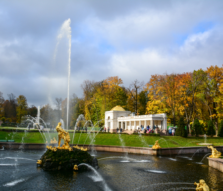 olympus: St Petersburg, Russia - Oct 9, 2016. The Grand Cascade at autumn in Peterhof Palace, Saint Petersburg, Russia. The Peterhof Museum is one of the most popular museums in Russia.