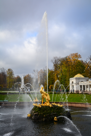 petergof: St Petersburg, Russia - Oct 9, 2016. The Grand Cascade at autumn in Peterhof Palace, Saint Petersburg, Russia. The palace along with the city center is recognized as a UNESCO Site.