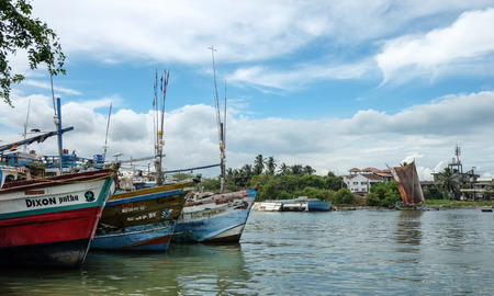 colombo: Colombo, Sri Lanka - Sep 5, 2015. Many fishing boats docking in pier at a village in Colombo countryside, Sri Lanka. Colombo is the largest city of Sri Lanka.