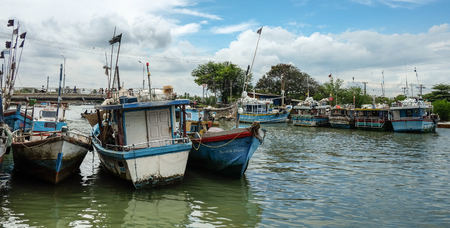 colombo: Colombo, Sri Lanka - Sep 5, 2015. Many wooden boats docking in pier at a village in Colombo countryside, Sri Lanka. Colombo is the largest city of Sri Lanka. Editorial