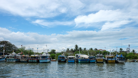 sep: Colombo, Sri Lanka - Sep 5, 2015. Many fishing boats docking in pier at sunny day in Colombo countryside, Sri Lanka. Colombo is the largest city of Sri Lanka. Editorial