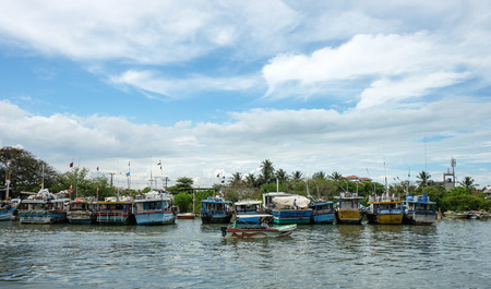 colombo: Colombo, Sri Lanka - Sep 5, 2015. Many fishing boats docking in pier at sunny day in Colombo countryside, Sri Lanka. Colombo is the largest city of Sri Lanka. Editorial