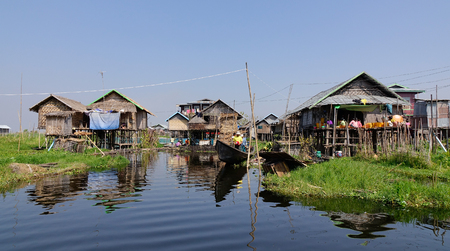 entrapment: Inle, Myanmar - Feb 14, 2016. Traditional wooden stilt houses at the Inle lake, Myanmar. Inle Lake is a freshwater lake located in the Nyaungshwe Township of Shan State.