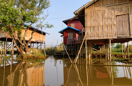 entrapment: Bamboo stilt houses at the floating village on Inle lake in Shan state, Myanmar. Inle is one of the highest lakes at an elevation of 2,900 feet (880m). Stock Photo