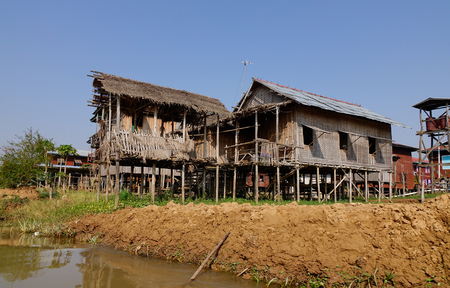 entrapment: Traditional wooden stilt houses at the Inle lake, Shan state, Myanmar. The people of Inle Lake (called Intha) live in four cities bordering the lake. Stock Photo