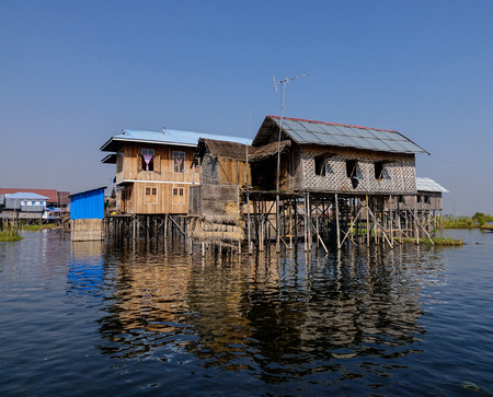 Traditional floating houses on the Inle lake, Shan state, Myanmar. Inle Lake is a major tourist attraction, and this has led to some development of tourist infrastructure.