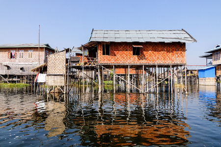 Traditional houses at floating village on the Inle lake, Shan state, Myanmar. Inle Lake is a major tourist attraction, and this has led to some development of tourist infrastructure. Stock Photo