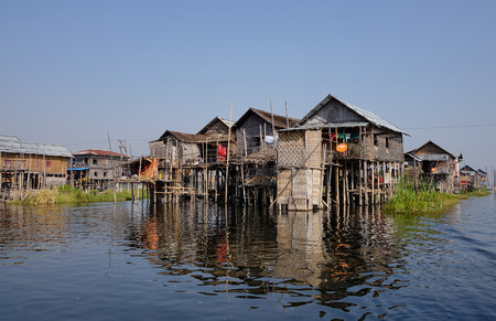INLE LAKE, MYANMAR - FEB 15, 2015. View of floating village on Inle lake, Shan state, Myanmar. Most transportation on the lake is traditionally by small boats.