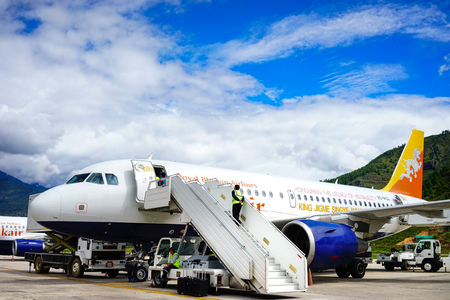 Thimphu, Bhutan - Aug 29, 2015. Airplanes docking at Paro Airport in Thimphu, Bhutan. Bhutan is a landlocked country and the second largest Himalayan state in Asia. Editorial