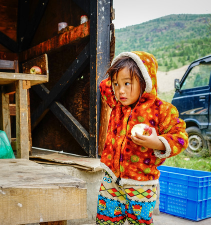 impoverished: Thimphu, Bhutan - Aug 29, 2015. A Tibetan girl playing at the local market in Thimphu, Bhutan. Bhutan ranks first in economic freedom, ease of doing business and peace. Editorial