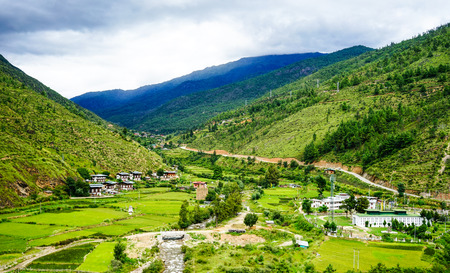 Mountain scenery with green valley in Thimphu, Bhutan. Bhutan is located on the southern slopes of the eastern Himalayas.