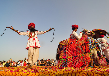 PUSHKAR, INDIA - MAR 7, 2012. Rajasthani folk dancers in colorful ethnic attire perform in Pushkar, India. Pushkar, textured with the myth and meditation is known for its rich cultural heritage.